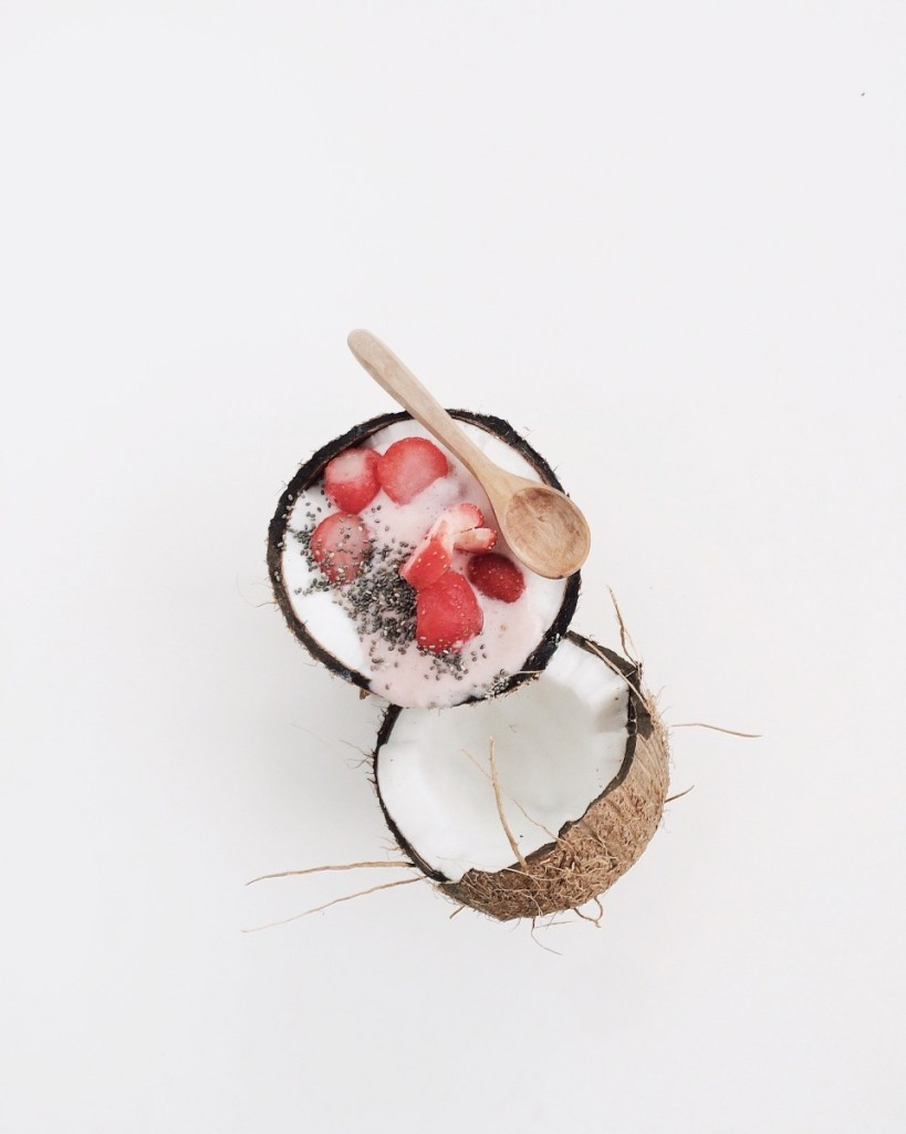 strawberry coconut chia seed pudding recipe in a coconut shell
