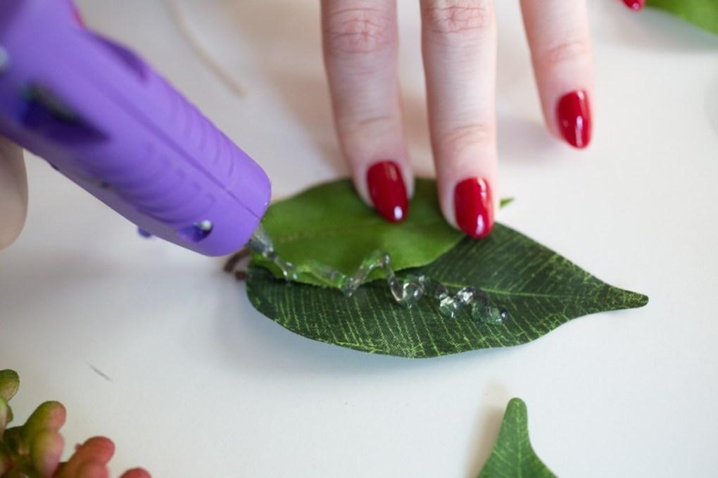 add hot glue to leaves pop shop america boutonniere tutorial