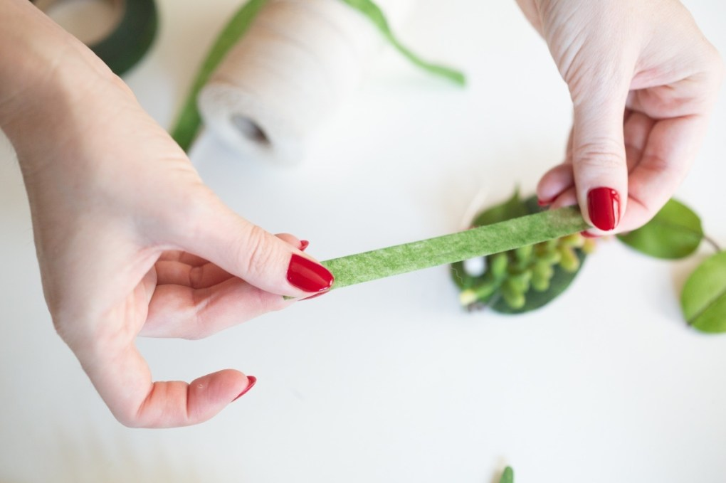 stretch the floral tape to make diy succulent boutonnieres