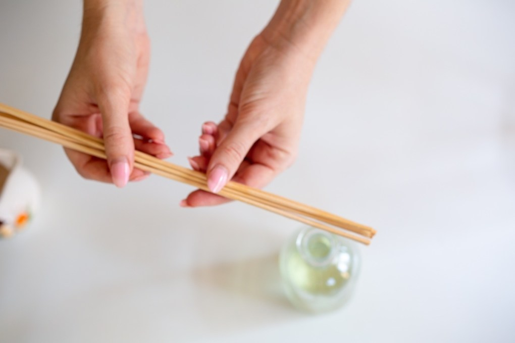 adding the reeds to your essential oil diffuser pop shop america