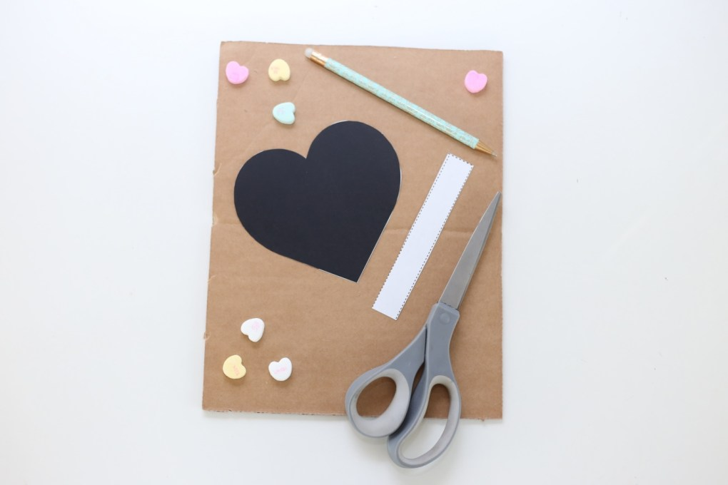 trace the template on the cardboard diy heart pinata