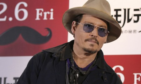 """U.S. actor Johnny Depp poses for photographers during a photo session prior to a press conference to promote his latest film """"Mortdecai"""" in Tokyo, Wednesday, Jan. 28, 2015. (AP Photo/Eugene Hoshiko)"""