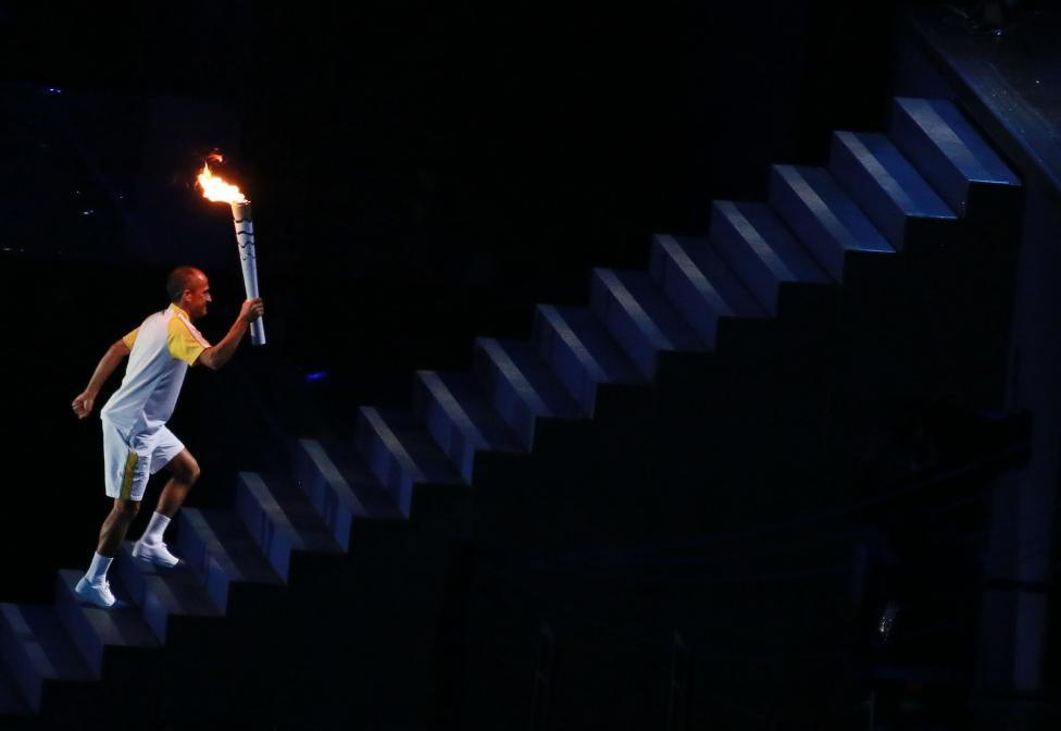 Vanderlei Cordeiro de Lima prepares to light the Olympic flame. REUTERS/Reinhard Krause