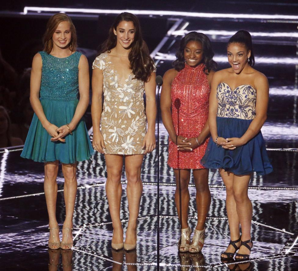 U.S. Olympic gymnasts Madison Kocian, Aly Raisman, Simone Biles and Laurie Hernandez appear on stage. REUTERS/Lucas Jackson