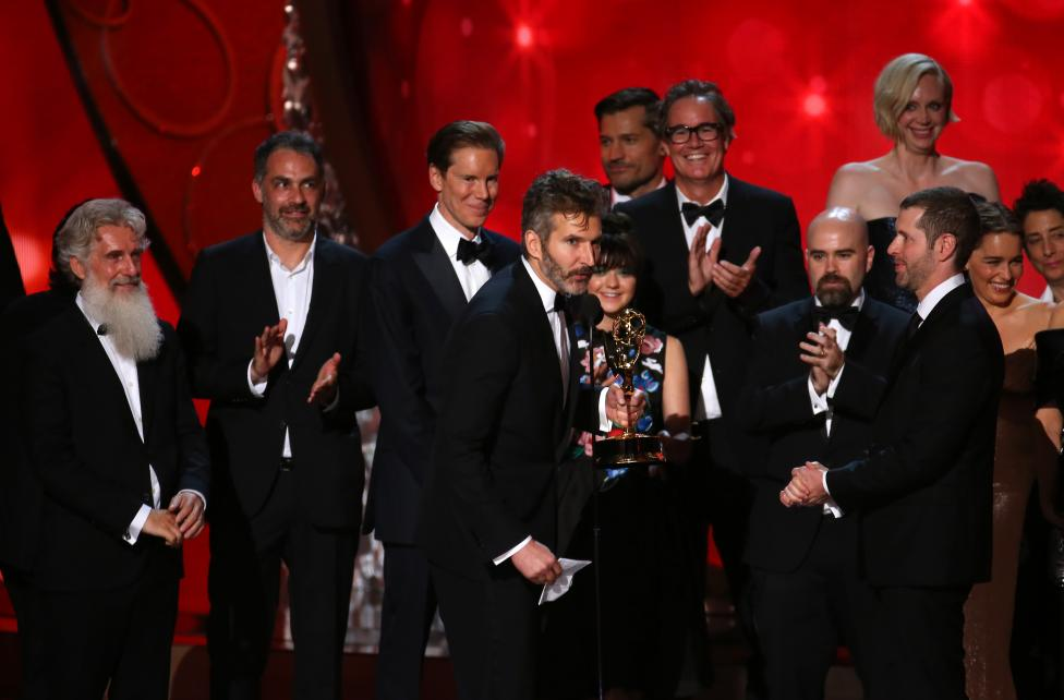 """Executive Producers David Benioff (C) and D.B. Weiss (R) accept the award for Oustanding Drama Series for """"Game of Thrones"""". REUTERS/Mike Blake"""