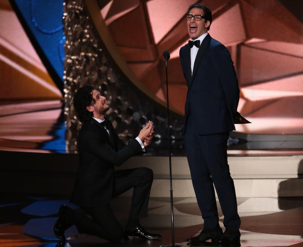 Kit Harrington and Andy Samberg (R) act as they present an award. REUTERS/Mike Blake
