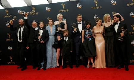 """The cast of HBO's """"Game of Thrones"""" pose backstage with their award for Oustanding Drama Series. REUTERS/Mario Anzuoni"""
