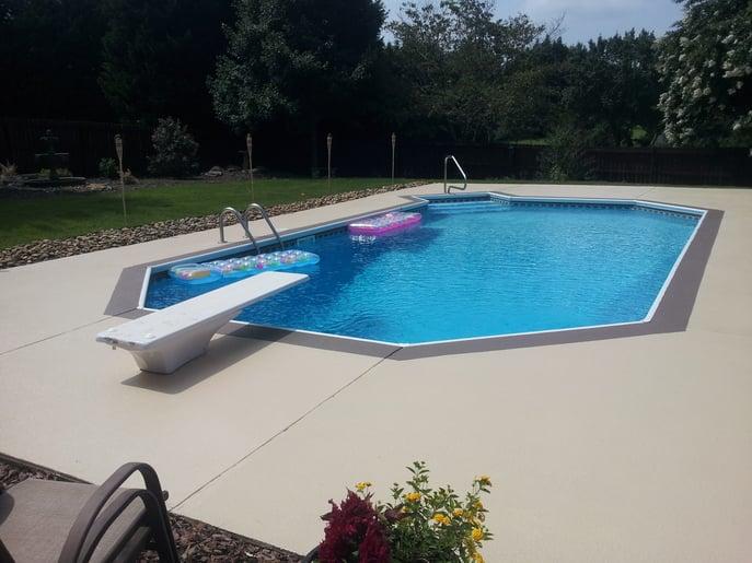 a pool deck with decorative concrete