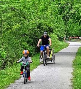 Family cycling on Lynn Valley Trail