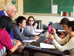 Volunteer Rod Cox helps Franklin High School students during a resume building workshop.