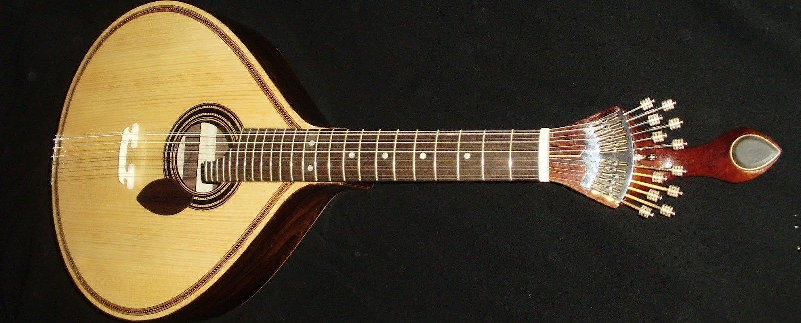 http://construcoesmestrebilu.blogspot.ru/2012/03/guitarra-portuguesa-de-coimbra-prima.html