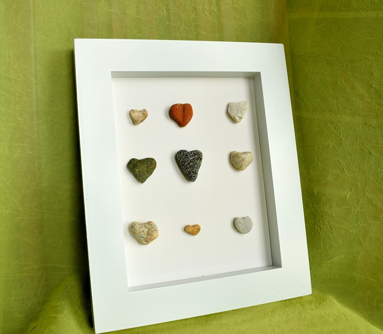 framed beach heart stones