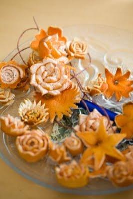 Various flowers out of orange peels