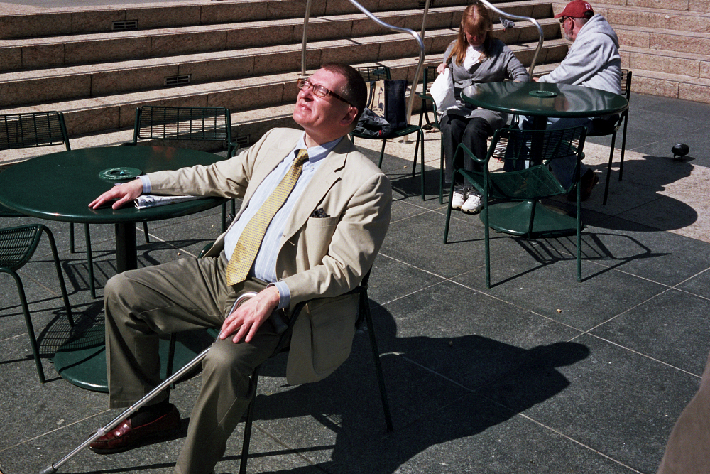 04-A-well-dressed_man_enjoying_the_sun