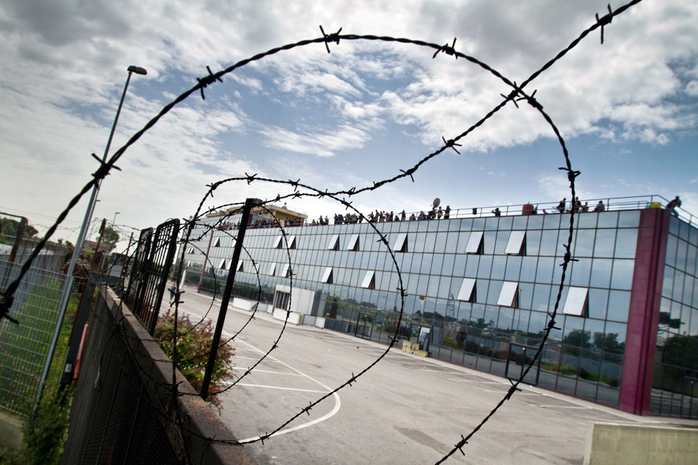 1- The Hotel is surrounded by barbed wire and barricades built by new tenants