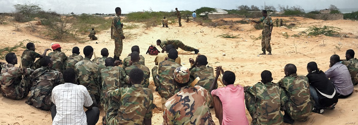 Mogadishu, SOMALIA 24.05.2014 Somali National Army trainees get put through their paces on their base near Mogadishu Airport. Rick Findler / Story Picture Agency