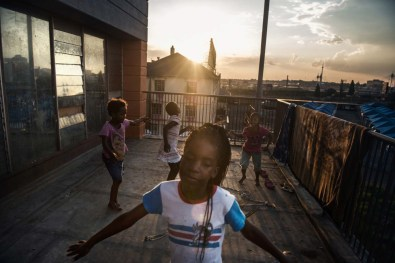 """Some of the Moth children playing on the balcony, they skipping rope and singing songs. One of the songs goes """"The cockroach is in my house, the cockroach is in my house!"""". Johannesburg 2015"""