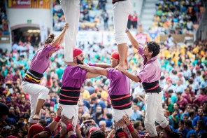 Castellers (people) going up from the bottom of the pinya.