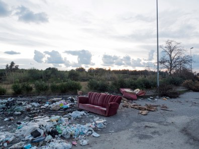 Italy, Calabria, Rosarno. 2015. The shacks are furnished with materials from the landfill.
