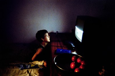 Pelopidas, the small brother of Kyriakos plays with his playstation watching a half-broken screen. But it doesn't seems to bother him.