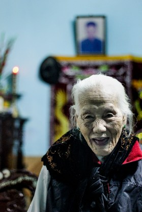 90 year old Mrs. Thuan in her home in Hue.