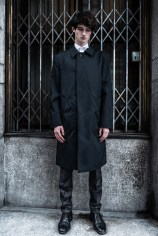 coat Prada, trousers H&M, shirt Valentino, shoes belong to the model