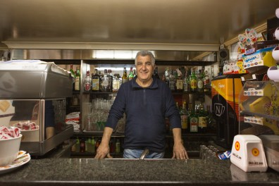 "Antonio, 52, 40 years of work at the ""Bar Gervasi"" in the main square of Riace. Like many Riace inhabitants sees the arrival of immigrants in a positive way in his country."