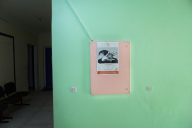 "A poster on violence against women hanging at the Association ""El Amane pour le femme et l'enfant""."
