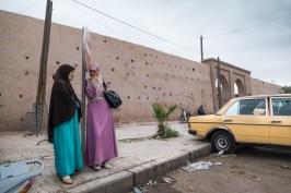 Two women outside Medina's walls.