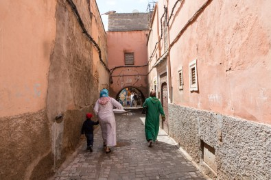 Two women and a child walk away after doing some shopping at the Marrakesh market.