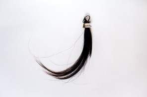 Spirits of ancestors descend grace and happiness from heaven through horsehair from the upper world. Black horsehair is considered as an attribute of doctoring.