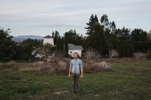 William Ryan Fritch Standing Outside His Rustic Farmhouse, Photo By Nathaniel Wood