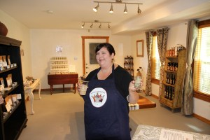 Sonoma Spice Queen Holding Spices and Spiced Iced Coffee, Photo by Wayne Dunbar