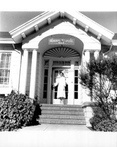 Nurse at doorway of Petaluma General Hospital