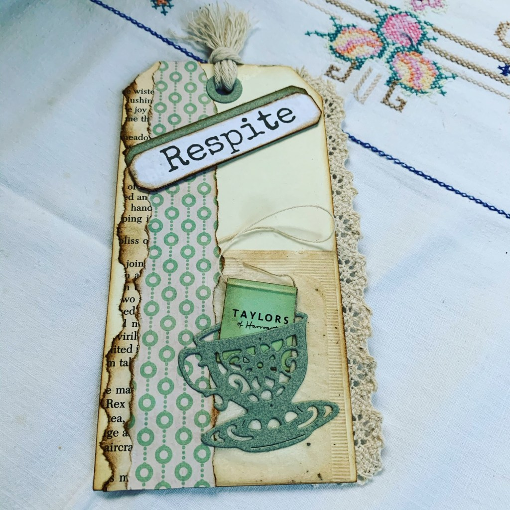 Respite - a little rest. This handmade tag shows some of what my respite often consists of... crafting, a cup of tea, and a little reading.