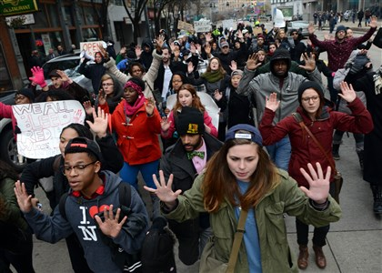 20141204MWHprotestLocal17-1 Protesters rally against police brutality and racism by marching with their hands up along Liberty Avenue, Downtown.