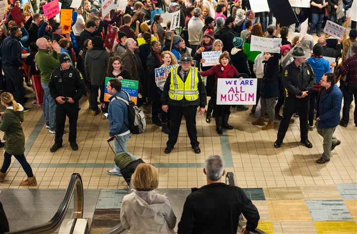 No Ban Protests at Pittsburgh International Airport People protest President Donald Trump's travel ban at the baggage claim area at Pittsburgh International Airport in Moon on Sunday.