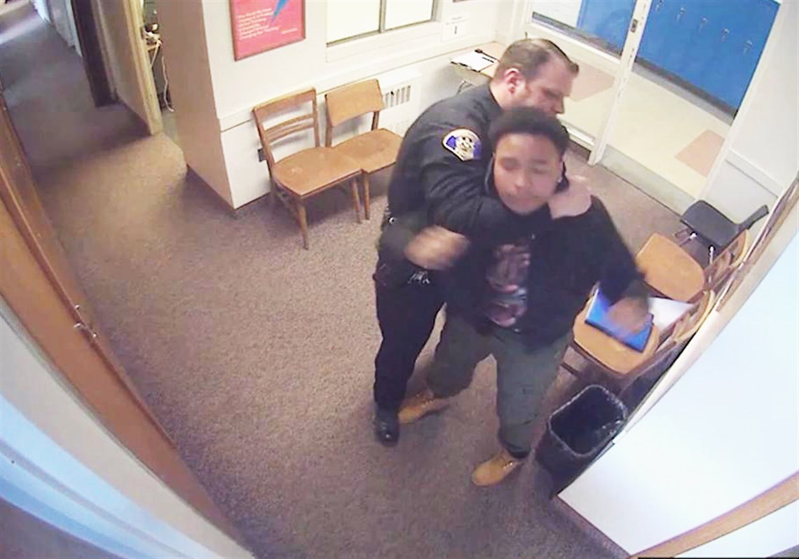 This screengrab from surveillance videos released Tuesday by attorney Todd Hollis shows an incident involving a Woodland Hills student being subdued in a school office by police and school officials.