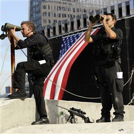In this 2011 file photo, Secret Service snipers keep watch from the roof of the Sept. 11 Memorial Museum during the ceremony to mark the 10th anniversary of the attacks on the World Trade Center in New York.