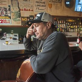 Mark Benz, 49, of Brentwood, talks about the day he lost two friends to the same batch of fentanyl as he has a beer at Character's Lounge in October along Brownsville Road in Carrick.
