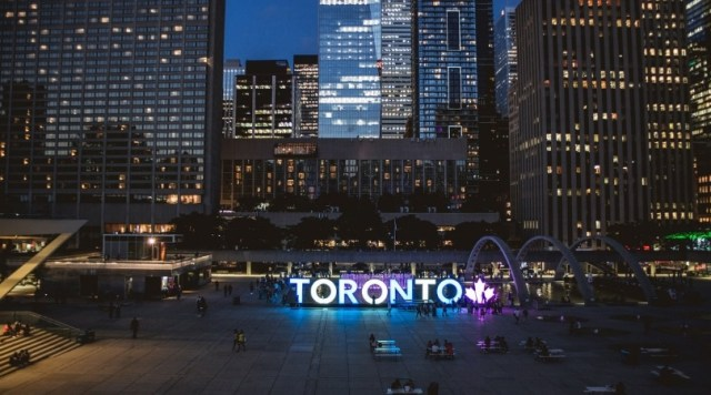 Toronto Sign lit at night - City Hall