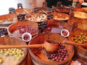 half-barrels filled with olives