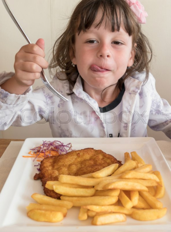 Little Italian girl eating fries