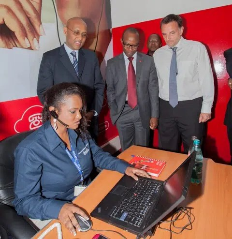 (L-R standing) Industrialization Cabinet Secretary Adan Mohammed with Coca-Cola's Kelvin Balogun and Nairobi Bottlers' Patrick Pech at the newly launched Coca-Cola Consumer Interaction Centre, located at Nairobi Bottlers' Ltd. in Embakasi