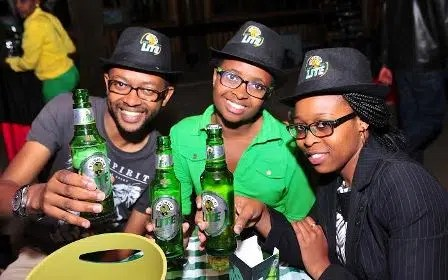 Some customers enjoy their Tusker Lite. Picture courtesy of EABL.