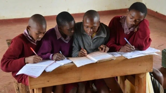 Kenyan students http://www.npr.org/2012/07/16/156840541/kenyas-free-schools-bring-a-torrent-of-students