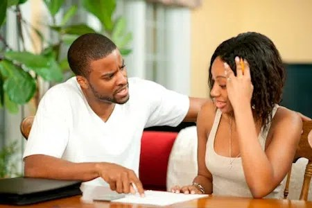Couple discussing money. Image from http://edenlifenigeria.com/should-couples-have-joint-accounts
