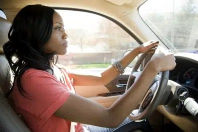 Woman driving. Image from http://ow.ly/UDO6Y