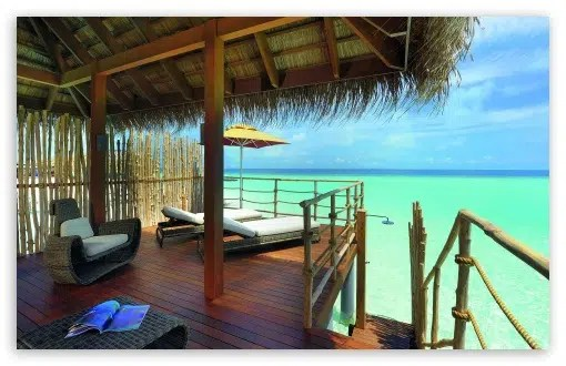 Vacation at the beach. Image from http://wallpaperswide.com/tropical_vacation-wallpapers.html