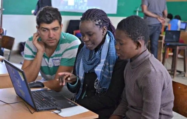 A girl being taught how to use computers. Image from http://simplydarrling.com/2015/08/intel-she-will-connect-ruth-edith-milycah-hope-for-careers/